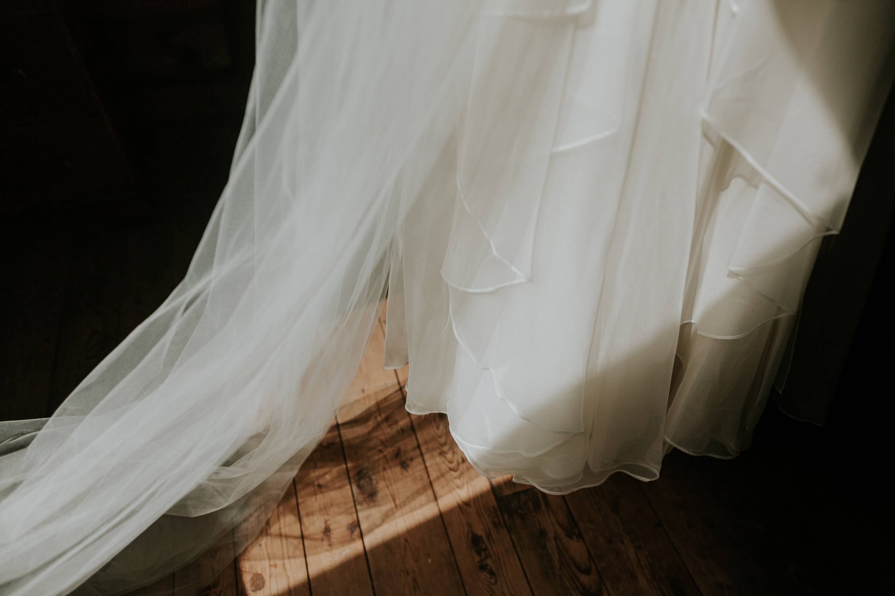 wedding dress in harsh light, flowy fabric of wedding dress, leanne marshall wedding dress