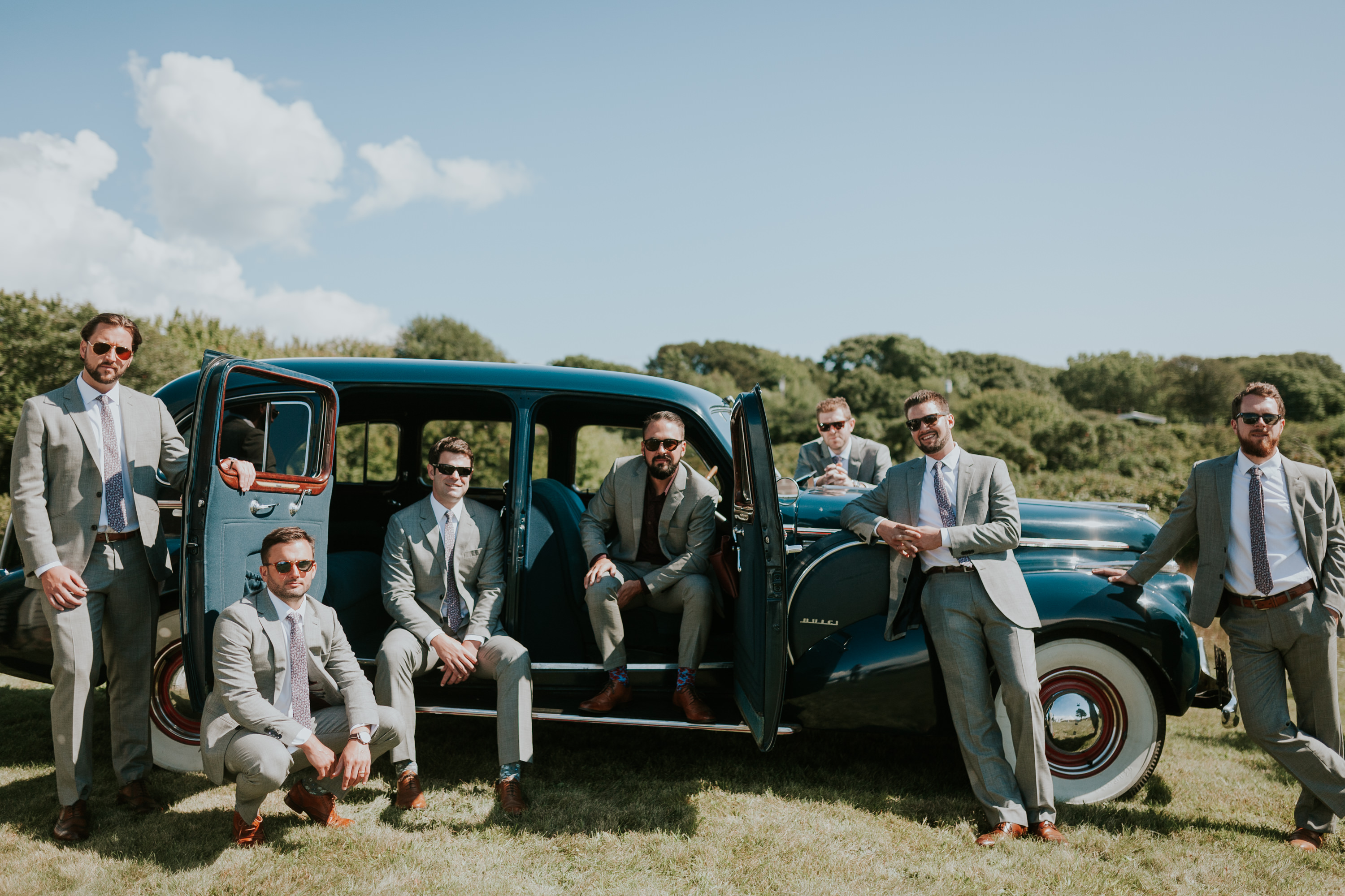 groomsmen in vintage car, groomsmen on the vineyard