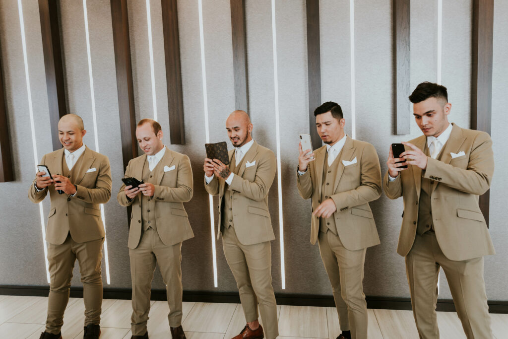 Groomsmen with cell phones