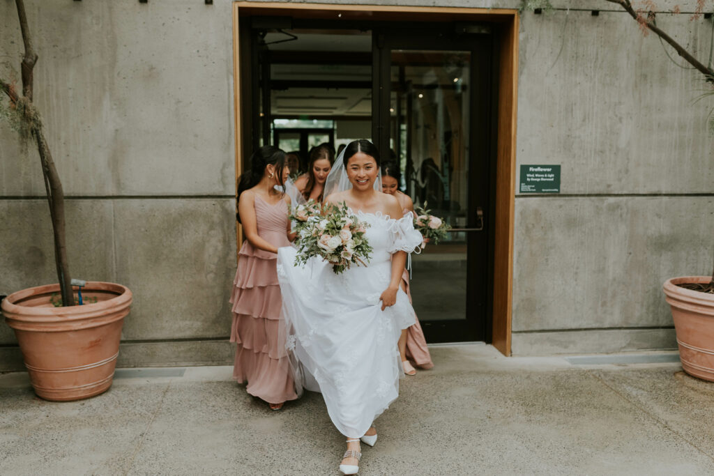 bride walking with wedding party