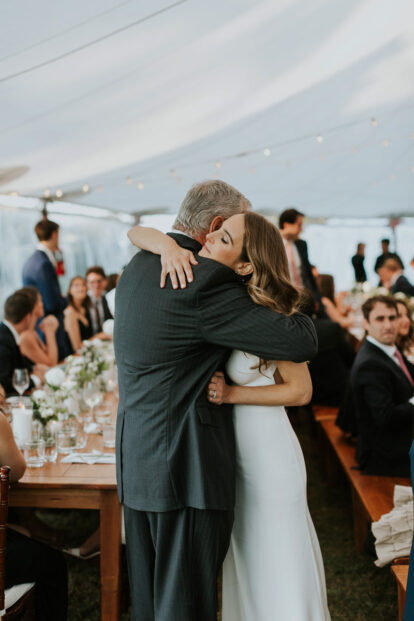 bride hugs her father after his speech at her Cape Cod wedding reception